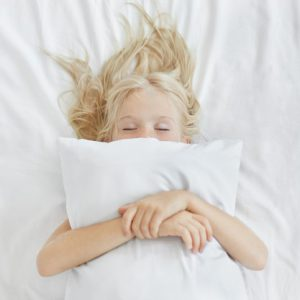 carefree-restful-little-girl-lying-white-bedclothes-embracing-pillow-while-having-pleasant-dreams-blonde-girl-with-freckles-sleeping-bed-after-spending-all-day-picnic-restful-child_273609-267